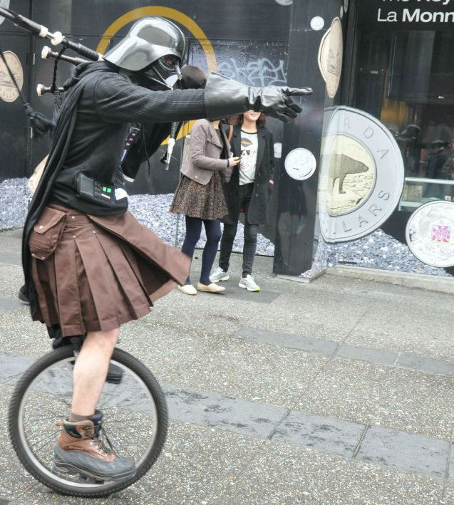 darth vader on a unicycle playing bagpipes